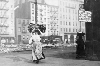 Immigrant Woman Walks Down Street Carrying a Pile of Clothing on Her Head  Fine-Art Print